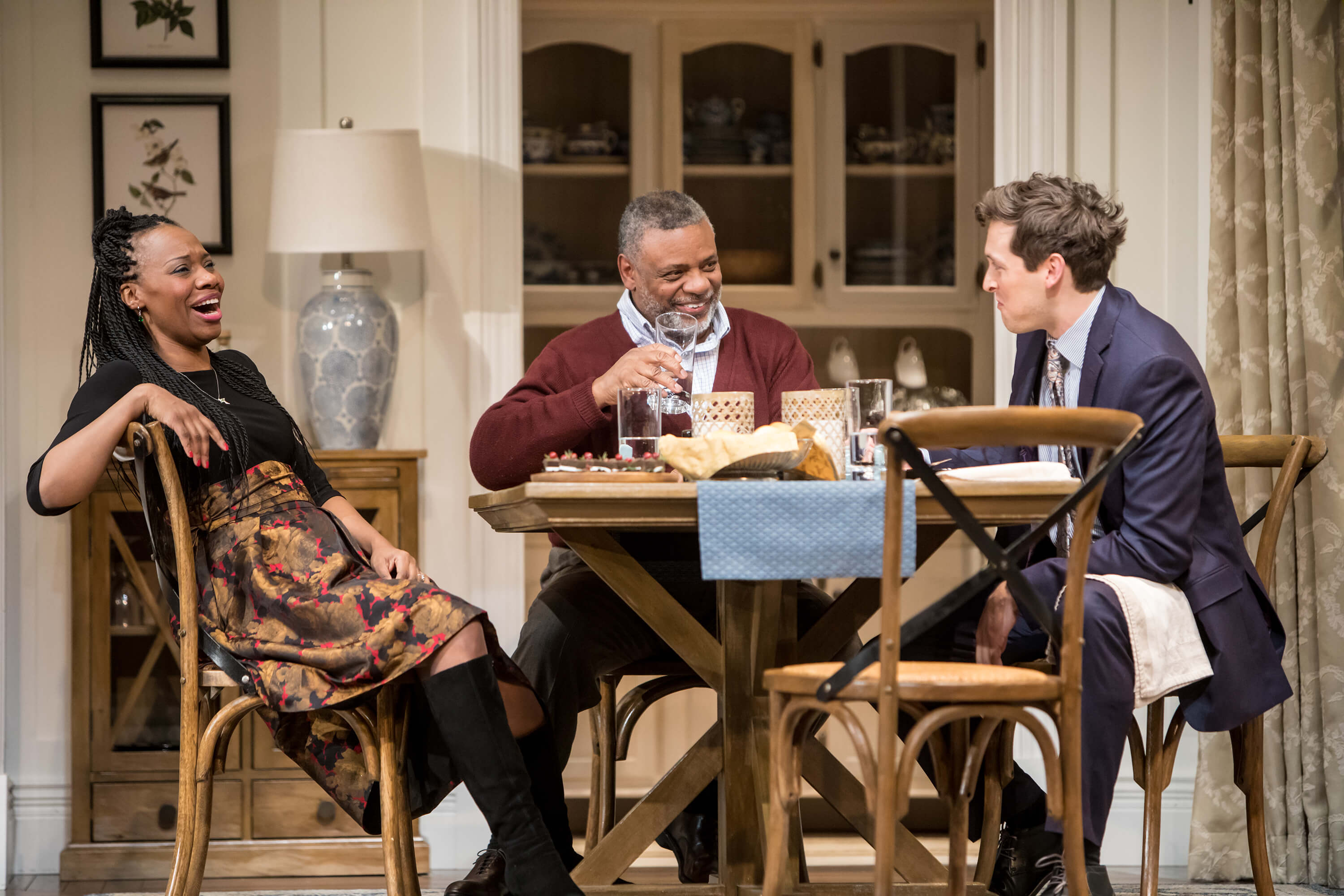 Shá Cage (Tendi), Harvy Blanks (Donald Chinyaramwira) and Quinn Franzen ( Chris) in the the Guthrie Theater's production of Familiar. Photo by Dan  Norman.